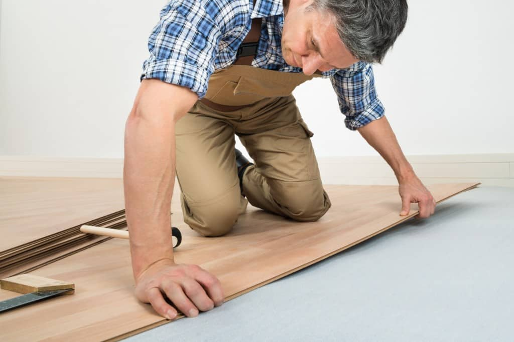 Man Installing Wood Floor on Knees 1024x683 - Resources - Hardwood Flooring San Diego