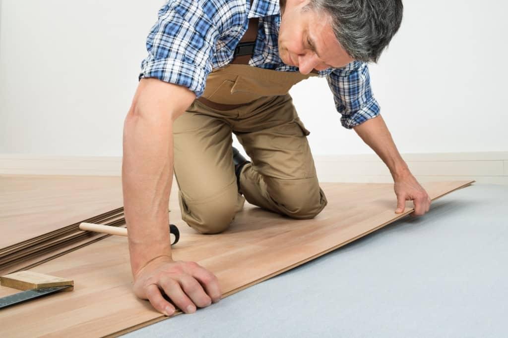Man Installing Wood Floor on Knees 1024x683 - Resources - Hardwood Flooring San Diego